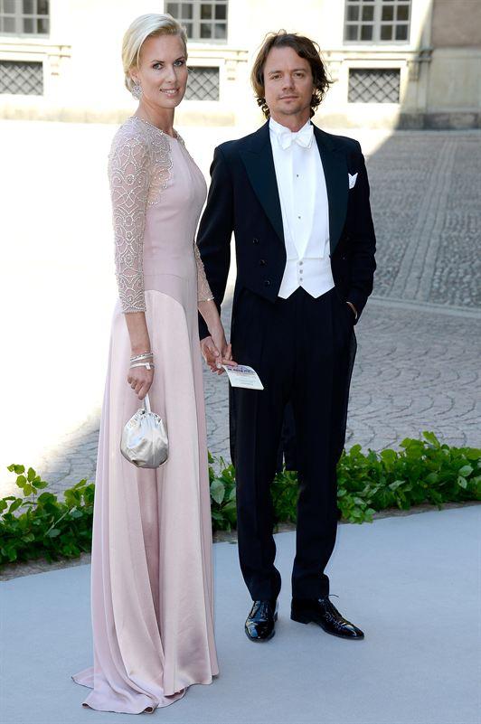 Unos invitados de la boda de Magdalena de Suecia